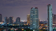 View of skyscrapers in Bangkok at night Stock Footage