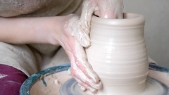Woman forms the shape of a jug of white clay Stock Footage