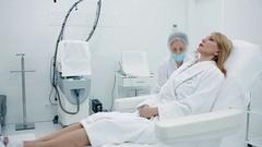 Eldery woman in a beauty clinic Stock Footage