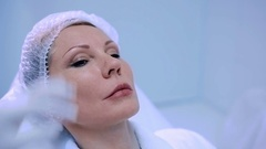 The beautician planning botox injections on lips Stock Footage
