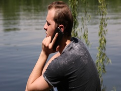 Hipster Young Boy Mobile Phone Call Friends Dialogue Park Lake Water Background Stock Footage