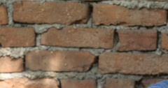 Young Sad Man Looking Camera Presentation Posing Serious Look Red Bricks Wall Stock Footage