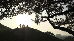 Silhouettes of people on top of the hill Stock Footage