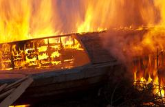 Burning an old boat Stock Photos