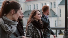Four beautiful young people two men and two women walk, talk, smile and laugh Stock Footage