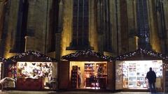 PRAGUE, CZECH REPUBLIC - DECEMBER 3, 2016. Christmas bazar booths near Saint Stock Footage