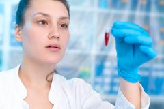 Woman technician with multipipette in genetic laboratory PCR research. Student g Stock Photos