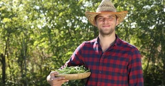 Happy Confident Farmer Man Hold Green Beans Show Vegetables Pile Posing Smiling Stock Footage