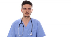 Young Doctor Man Respond Affirmative Answer to Question Healthcare Clinical Room Stock Footage