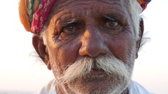 Rajasthani senior man in Jaisalmer Desert, India Stock Footage