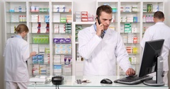 Pharmacy Store Activity Inventory Drug Medicine Pharmacist Man Talk Mobile Phone Arkistovideo