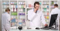 Pharmacy Store Activity Inventory Drug Medicine Pharmacist Man Talk Mobile Phone Stock Footage