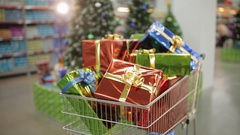 Shopping carts full of Christmas gifts. Christmas and shopping concept Stock Footage