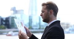 Business Man Holding Pie Chart Read Profit Statistics Urban Scene London Skyline Stock Footage