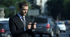 Business Male Send Message with Mobile Phone Teamwork Chat Crowded Intersection Stock Footage