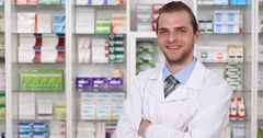 Attractive Portrait of Pharmacist Man Looking Camera Pharmacy Store Presentation Stock Footage