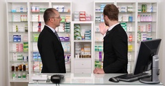 Two Successful Business Men Talking About Medicines Drugs in Drugstore Pharmacy Stock Footage