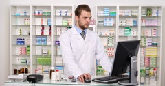 Pharmacist Man Using Computer Talking Phone Giving Negative Respond to Patient Stock Footage