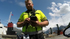 NORWAY, GEIRANGER: Passenger buys a ticket to the ferry, pays cash money Stock Footage
