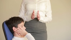 Receiving healing energy, boy with female hands hovering over his forehead Stock Footage