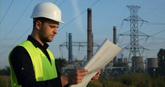Electrician Inspector Engineer Man Look Scheme Plan Examining Power Plant Area Stock Footage