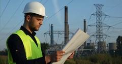 Electrician Inspector Engineer Man Look Scheme Plan Examining Power Plant Area Stock Footage