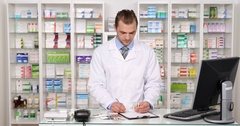 Busy Pharmacist Man Writing Clipboard Taking a List Medicine Pills Pharmacy Shop Stock Footage