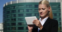 Corporate Business Woman Using Digital Tablet and Looking Camera Urban Scene Day Stock Footage