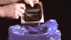 Coffee grounds being scraped into a plastic bag. Stock Footage
