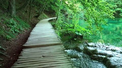 Walking through mountain forest near to the lake,. View from Plitvice lakes Stock Footage