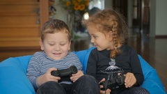 Cute boy and girl playing a game on the x-box Stock Footage