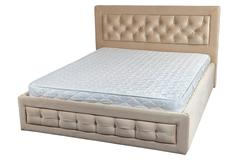 Wooden double bed with cream faux leather, and orthopedic mattresses. Stock Photos