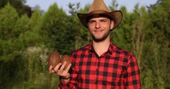 Farmer Man Showing Coconuts From His Tropical Farm Smiling and Looking at Camera Stock Footage