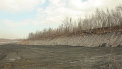Waste from black coal mining dumps, ash wasteland slow burn, pollution Stock Footage