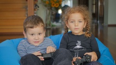 Cute children playing a game on the x-box Stock Footage