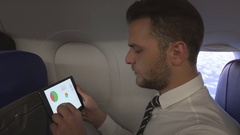 Busy Ceo Business Man Using Digital Tablet Examine Sales Report Airplane Travel Stock Footage