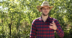 Happy Attractive Farmer Man Talking Holding Bio Red Pepper Examining Products Stock Footage