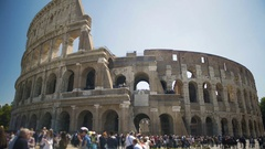 People walking near Coliseum amphitheater in the center of Rome, sightseeing Stock Footage