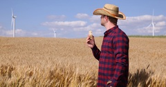 Hungry Farmer Man Worker Eating A Sandwich in Summer Heat on Wheat Field Farm Stock Footage