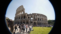 Creative shot of antique amphitheater Coliseum in Rome, tourists enjoying tour Stock Footage
