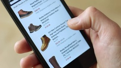 Men's boots. Online shopping using a smartphone Stock Footage