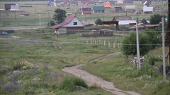 Blue car moves along the winding, crooked road. Altai. Valley. Village. Stock Footage