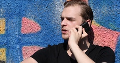 Caucasian Young Guy Talking a Mobile Phone Collaboration Team Graffiti Art Wall Stock Footage