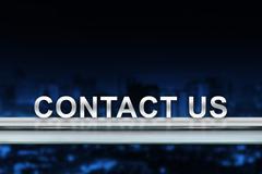 Contact us on metal railing Stock Photos