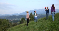 Beautiful Group of Friends Playing Volleyball Green Grass Mountain Team Building Stock Footage