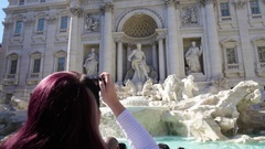 Young woman taking photo of amazing Poli Palace and Trevi fountain in Rome Stock Footage