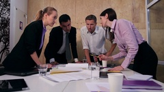 Bussiness people analyzing project at meeting Stock Footage