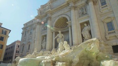 Neptune statue standing on famous Trevi fountain in Rome, ancient architecture Stock Footage