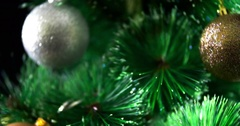 Decorated Christmas tree baubles rotation 4k extreme close-up video background Stock Footage