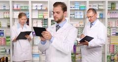Pharmacist Team Work Pharmacy Personnel Activity Drugstore Staff Presentation Stock Footage